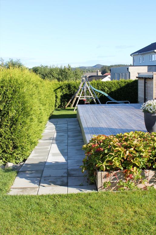 4 Seasons Garden. Rampen gir en direkte og lett kommunikasjonsvei ved transportbehov mellom de ulike sonene i hagen.