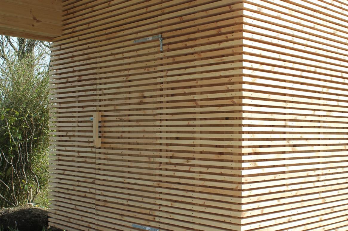 hagestue-på-kvernaland-04-bod-i-hage-saark-arkitekter
