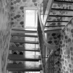 Renovering Enebolig på Tasta .Trappen er åpen for å slippe lyset inn i hallen.