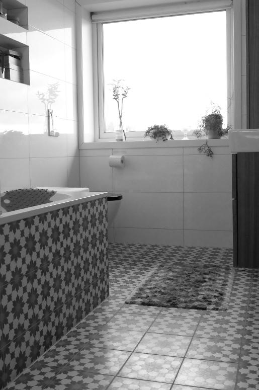 Renovering Enebolig på Tasta .Fliser på det nye baderommet.